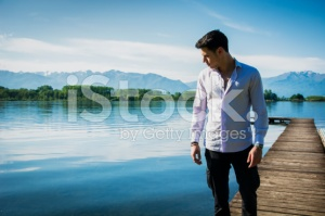 stock-photo-65016913-attractive-young-man-on-lake-in-sunny-peaceful-day